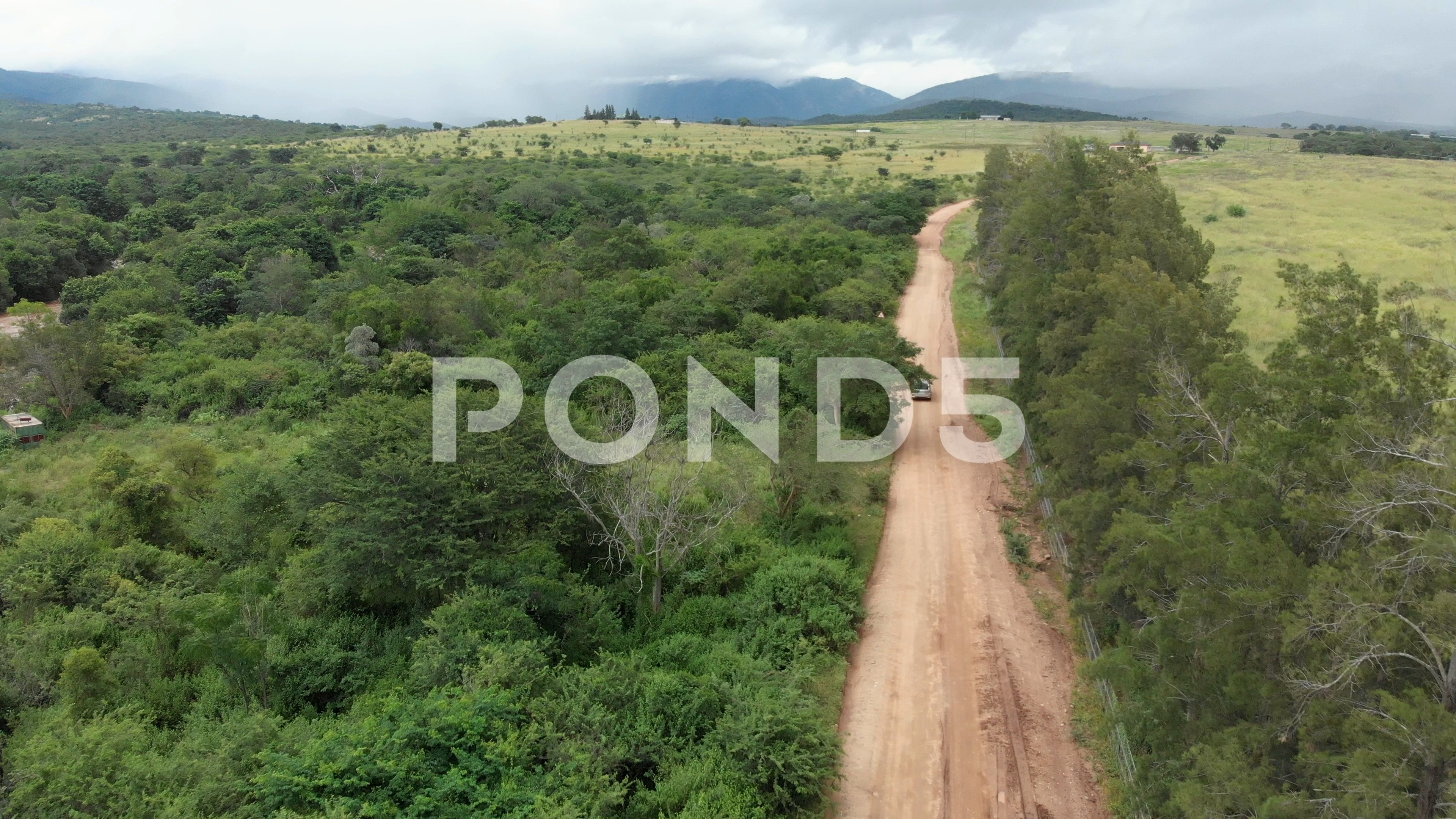 Aerial Drone Flying Behind Car Driving Along Old Dirt Road In African Stock Footage Ad Car Driving Flying Aerial Aerial Drone Aerial Stock Footage