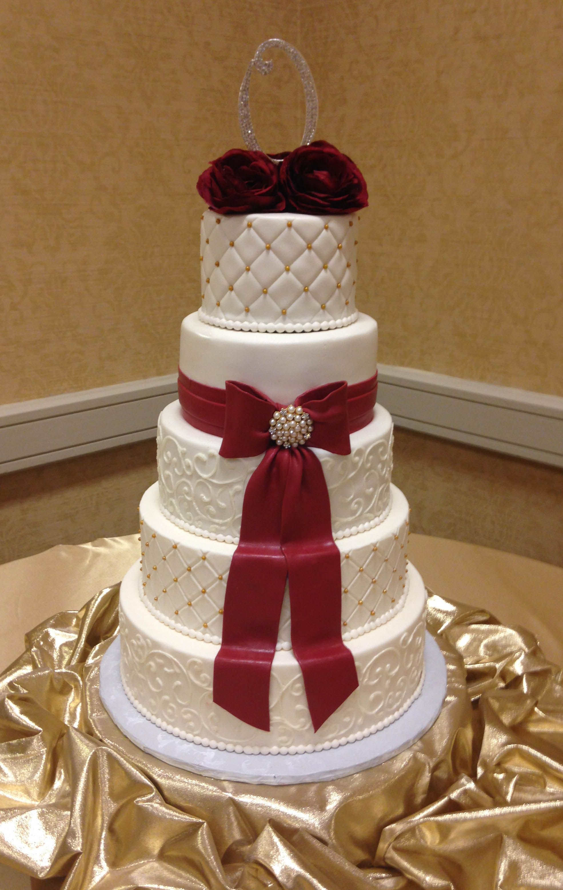 Crimson & gold classic wedding cake. blismcdonough