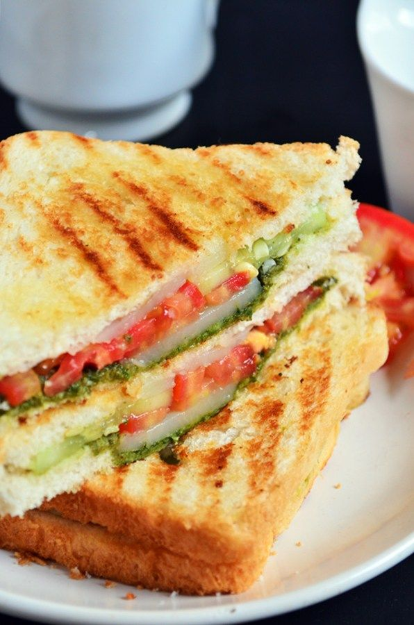 Our all time favorite breakfast/snack/lunch/dinner. Bombay grilled sandwich with loads of vegetables, green chutney and butter, grilled till crispy. Street style sandwich that is so addictive and delicious recipe @ http://cookclickndevour.com/bombay-grilled-sandwich-recipe