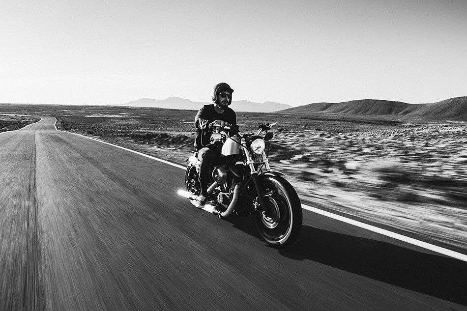 boy riding a harley davidson on an empty desert road photo motorcycles. Black Bedroom Furniture Sets. Home Design Ideas