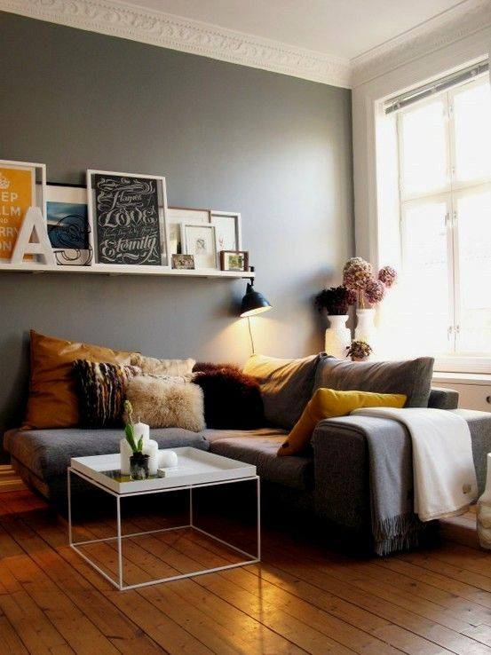 Living Room Interiors Inspiration \ Grey Walls \ Gray Walls \ Grey Sofa \  Mustard Yellow Accents \ White Floating Shelf With Picture Frames