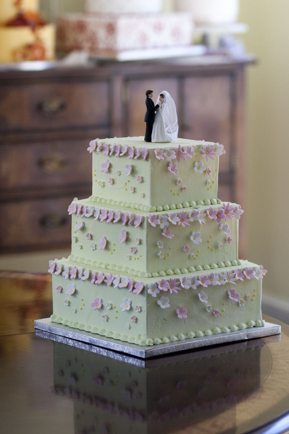 A pink and green floral cake would be great for a spring wedding