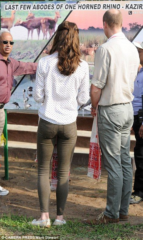 585381fa Kate keeps it casual with Zara jeans, a spotted blouse and tied back hair  while William opts for classic outfit of chinos and khakis as ...