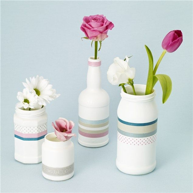 Collect empty jars and bottles and streamline them with white spray paint. Once they're dry, wrap combinations of tape around them to form co-ordinated vases.