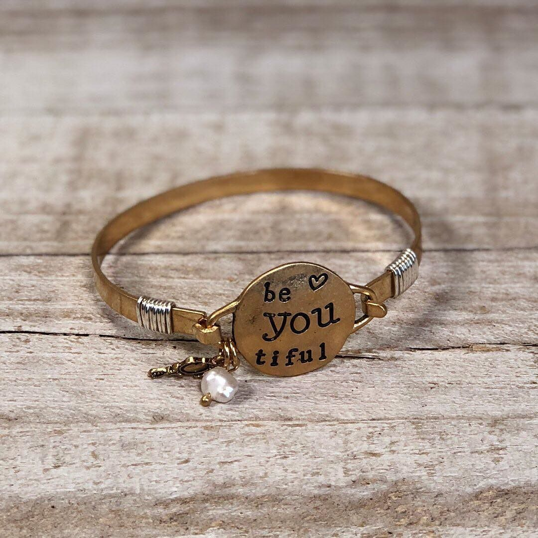 This gold bracelet is a great reminder that being you is what