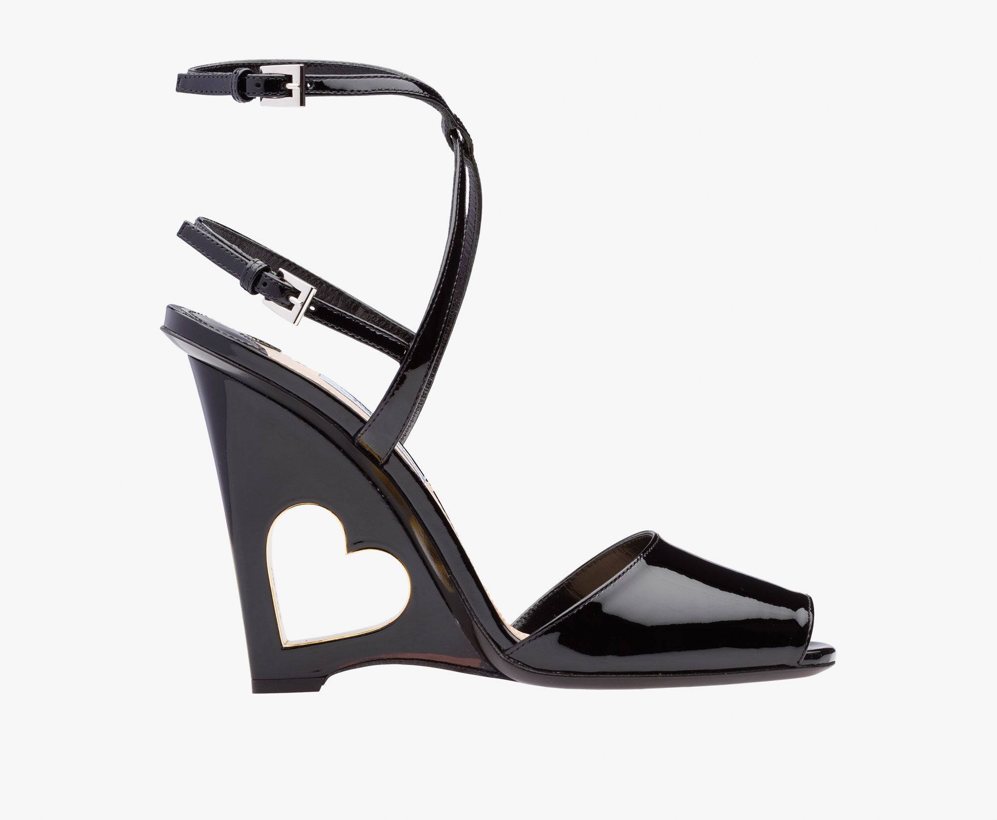 0a485450f1e Patent leather sandal Crisscross ankle strap Light wedge engraved with  heart motif inserted underneath the sole 110 mm heel