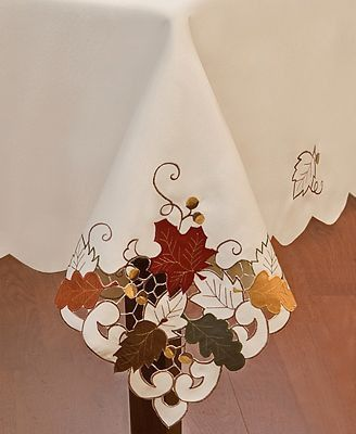 """Crafted with intricate cutwork, rich embroidery and suede detail, this easy-care Sterling Forest tablecloth captures the crisp, unmistakable cool of fall.        Polyester      Machine wash      Imported      60"""" x 140"""""""
