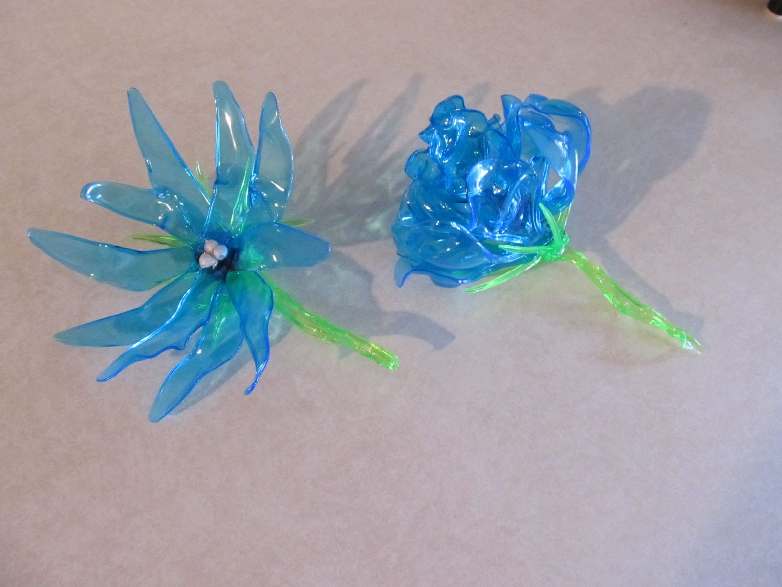 Two Flowers I Made From Plastic Spoons And Knives (petals) And Forks (stems