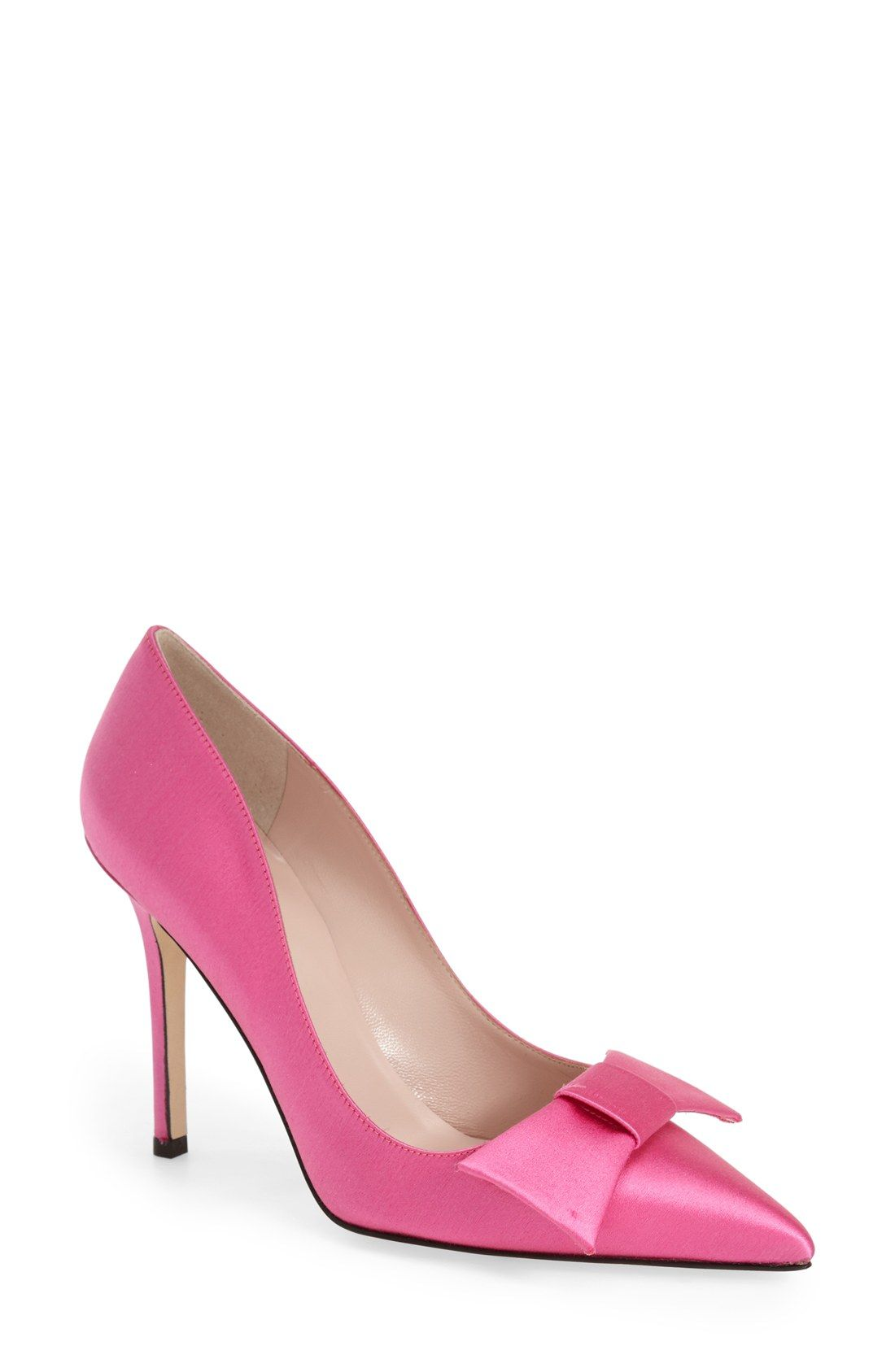 7b9666f0e12 A prim bow effortlessly refines this adorable pink Kate Spade satin pump.