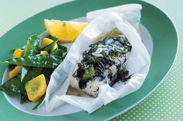 Lock in the freshness and flavour of the beautiful fish by steaming it inside a paper shell.