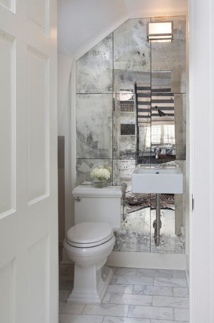 A Faded Mirror Wall Can Make A Tiny Powder Room Look Bigger And More Stylish At The Same Time Antique Mirror Bathroom Mirror Makeover Home Powder Room Small