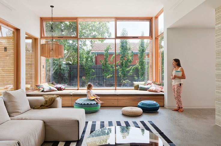 A Huge Daybed Beneath The Large Front Window Of This Melbourne Home Offers An Open Invitation T Window Seat Design Living Room Windows Contemporary Living Room
