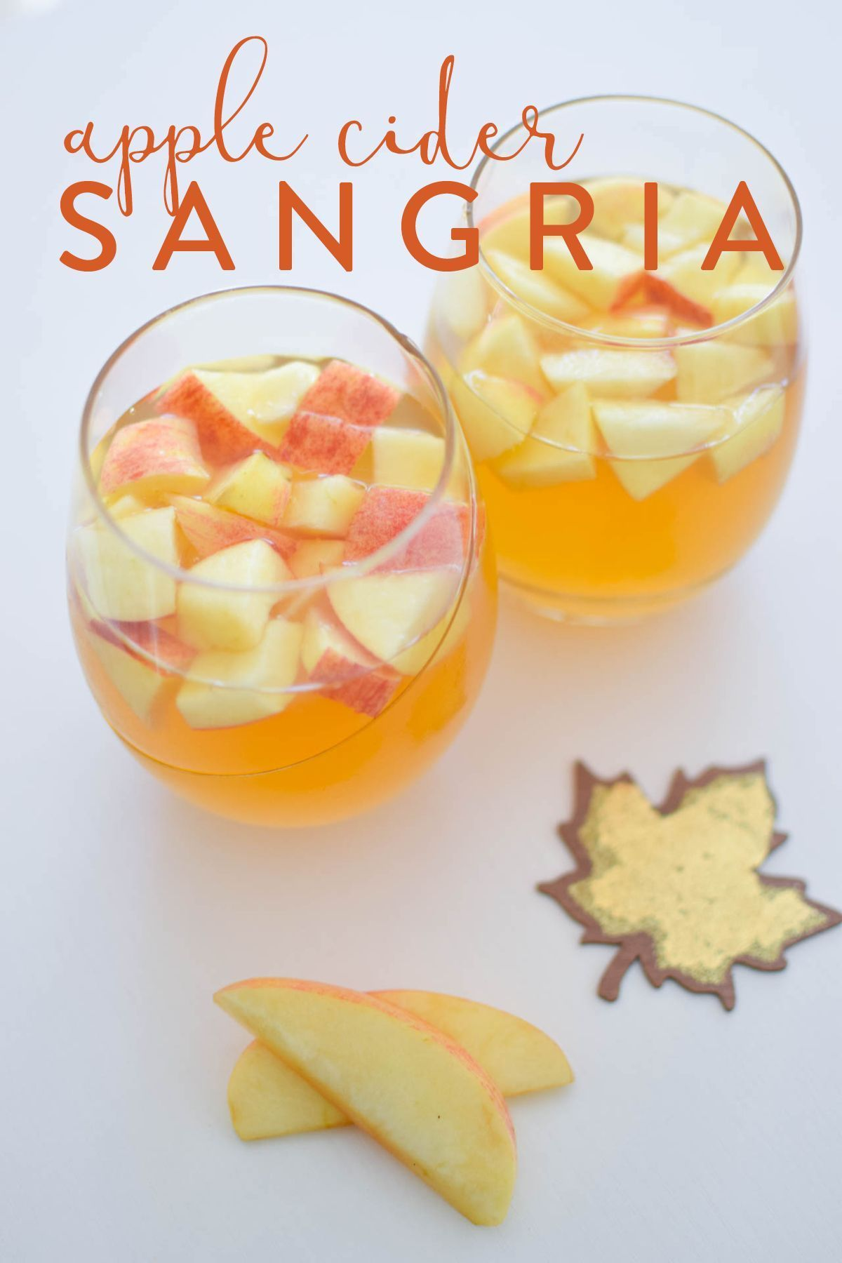 Apple Cider Sangria #applecidersangriarecipe An easy five-ingredient apple cider sangria recipe perfect for football tailgates and chilly fall dates. #applecidersangriarecipe Apple Cider Sangria #applecidersangriarecipe An easy five-ingredient apple cider sangria recipe perfect for football tailgates and chilly fall dates. #applecidersangriarecipe