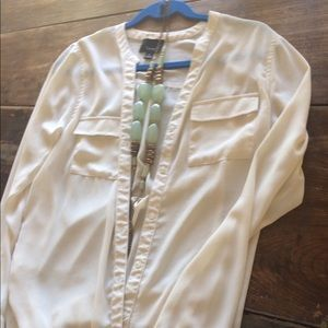 I just added this to my closet on Poshmark: Lumiere Medium Semi Sheer Ivory Button Down. Price: $22 Size: M