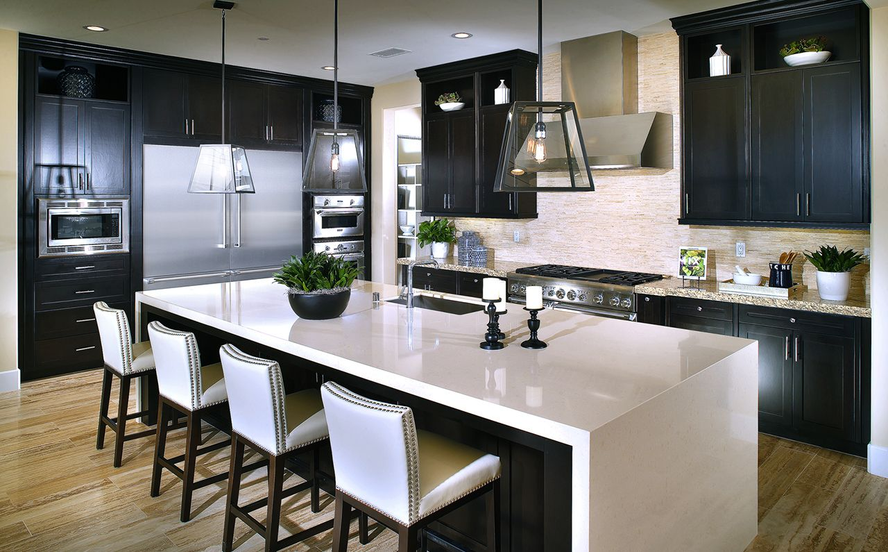 Residence geometric lamps light the oversized kitchen island at