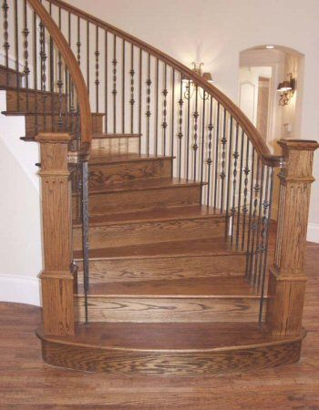 This Staircase Design Was Created Using Ribbon Series Balusters And Plain Round Bars To C Wrought Iron Stair Railing Wrought Iron Staircase Wrought Iron Stairs