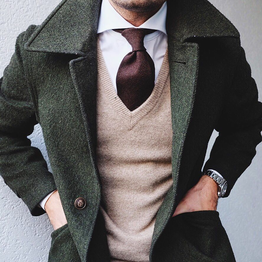 Green Jacket Over Camel Sweater Over White Collared Top With Brown