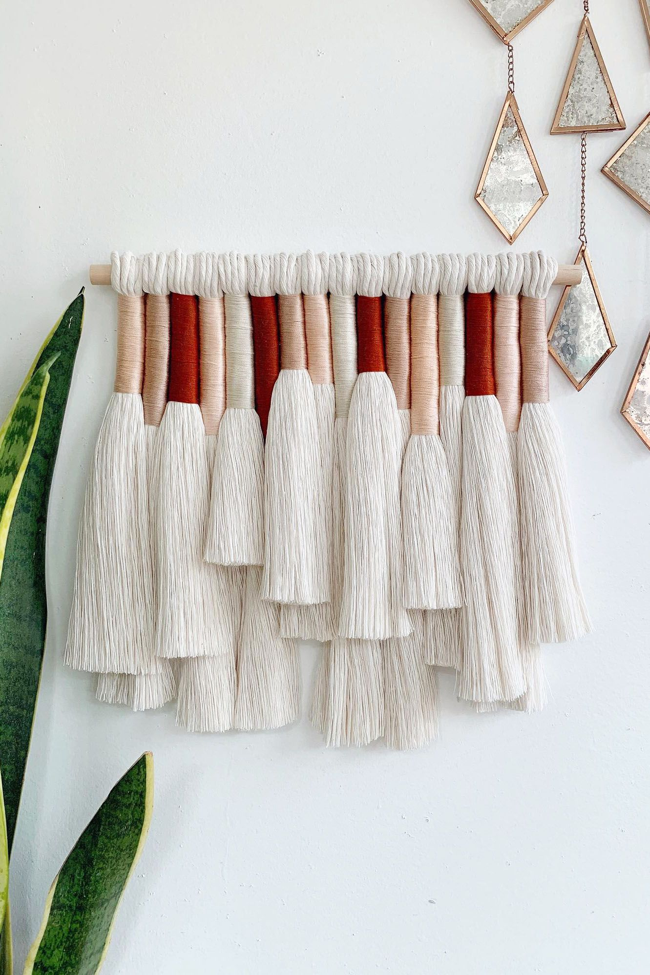 Stunning woven wall art for a living room or bedroom. A macrame wall hanging made with fine combed cotton rope and cotton thread adds a boho vibe to your home decor.