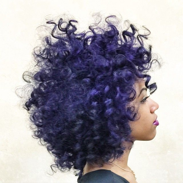 Stunning curly do with deep purple color.