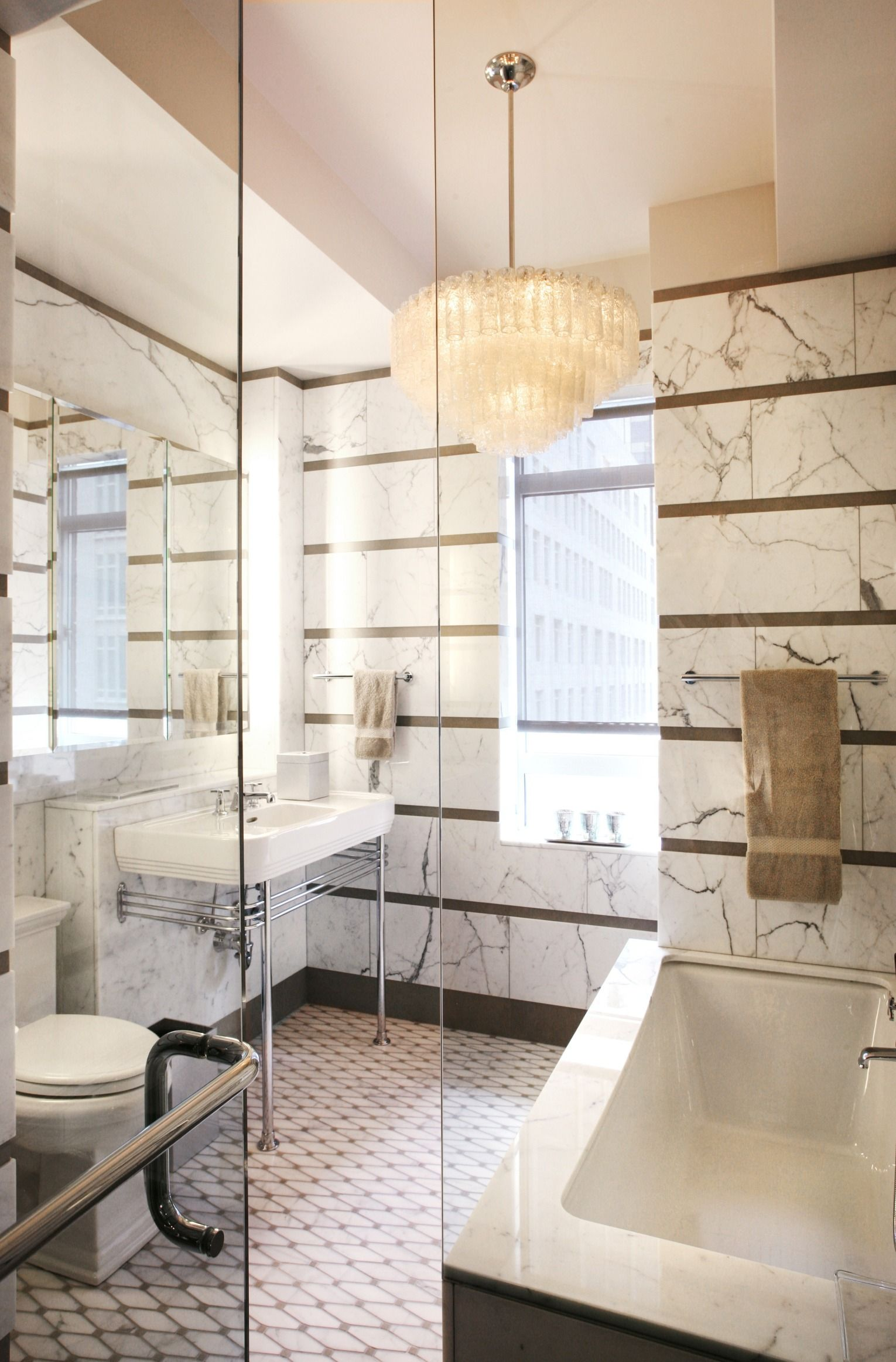 A Renovated New York Bathroom With Marble Walls And A Deco Inspired Bath |  Archdigest.com