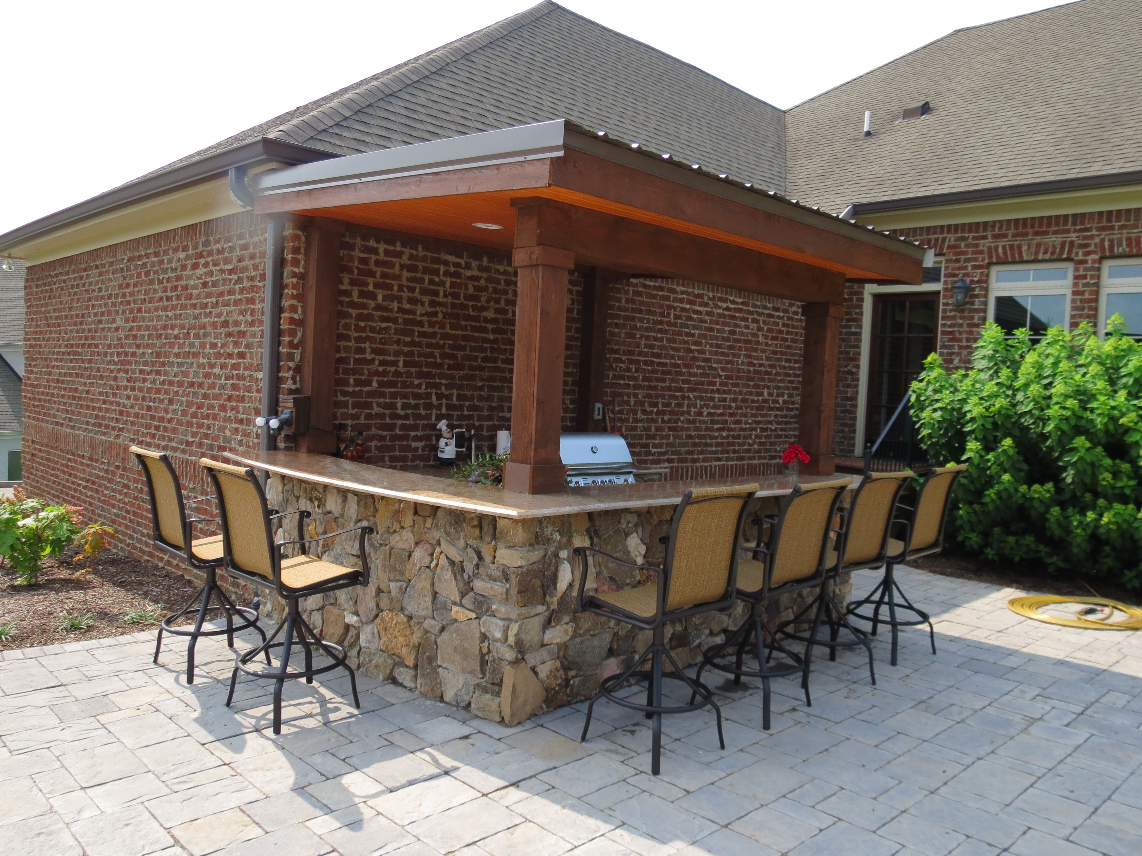 outdoor kitchen area with granite counter tops and natural stone www creativestonelandscaping on outdoor kitchen natural id=52491