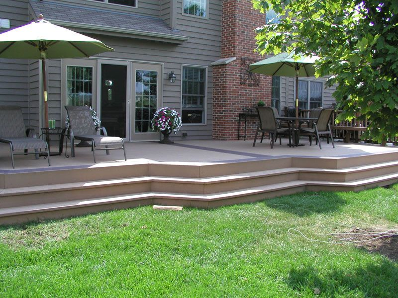 Plain deck with patio furniture that creates shade