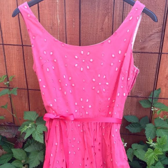 Beautiful coral pink cotton dress with belt waist Beautiful color coral Pink sun dress fit n flare with belted waist and cotton eyelette fabric and lining slip.  Sz 4 in very good condition zips up side, length is midi /about knee length has short tank sleeves. Perfect fashion for spring/summer!! Merona Dresses Midi