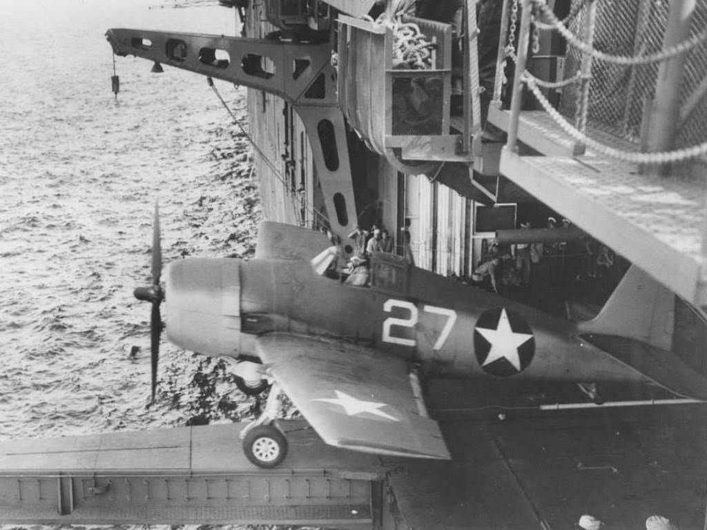 USNAVAIR F6F-3 Hellcat of VF-1 being catapulted from the hangar deck catapult on the carrier Yorktown (Essex-class) off Trinidad, 3 Jun 1943.