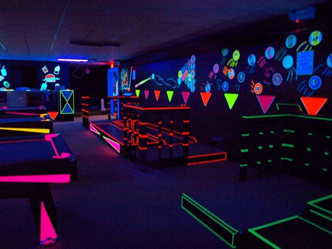 Awesome #blacklight decor for this cool #lounge area. Great photo via #CraftHubs