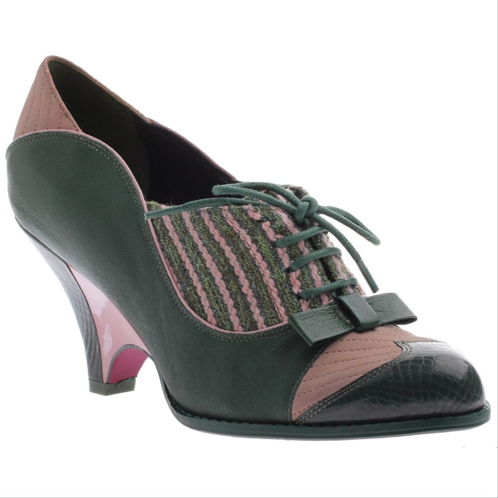 Vintage inspired heel worthy of Mary Poppins. Green snakeskin accents blend with dusty pink stitching, with a bow to boot.