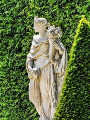 Ceres, the goddess of agriculture in Versailles gardens carrying a horn of plenty.