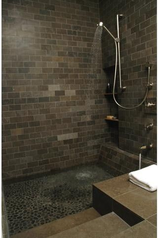 A shower, but also a bathtub... notice how it\'s sunk below floor ...