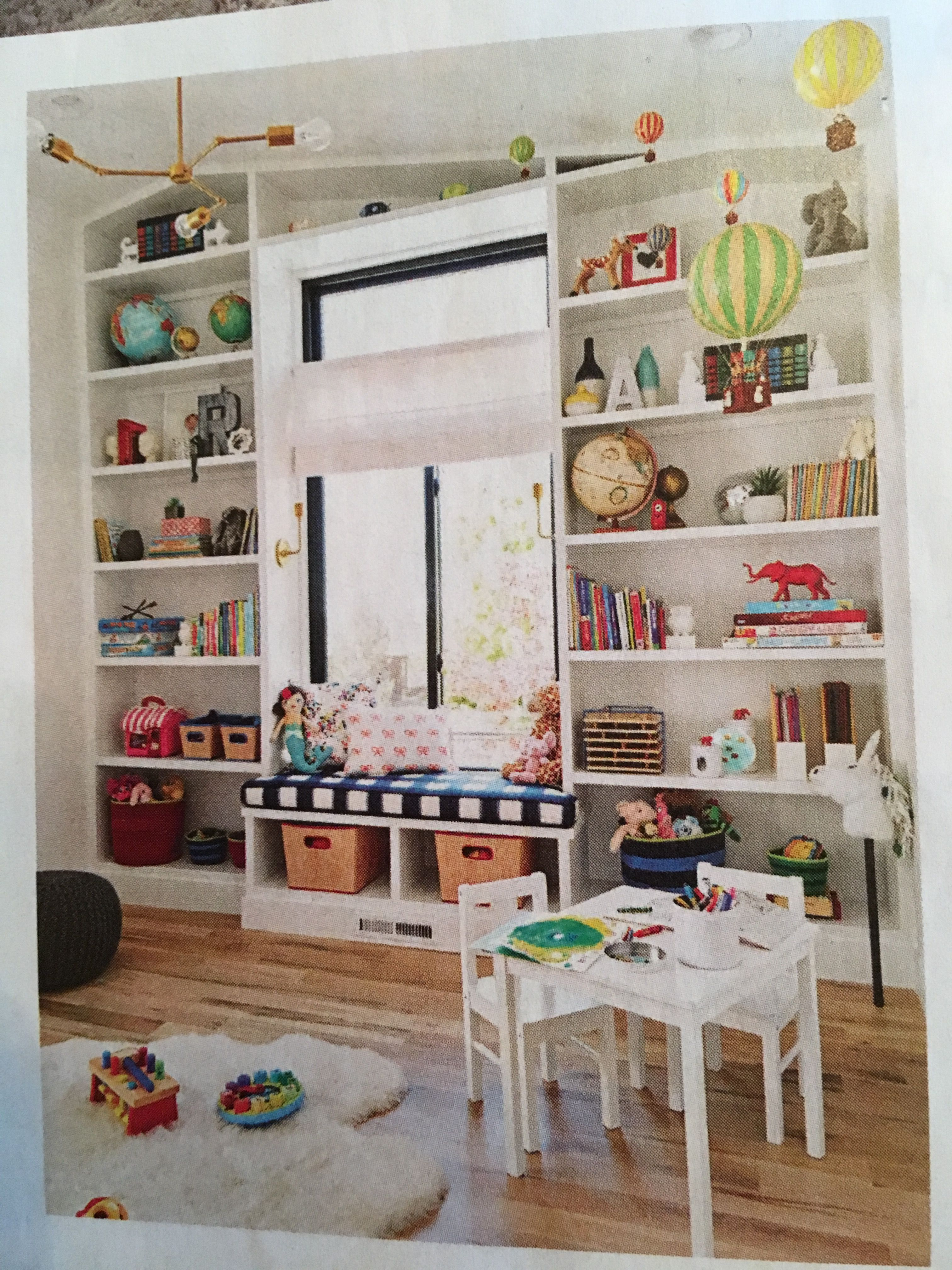 Builtin shelves around a window seat for books toys etc