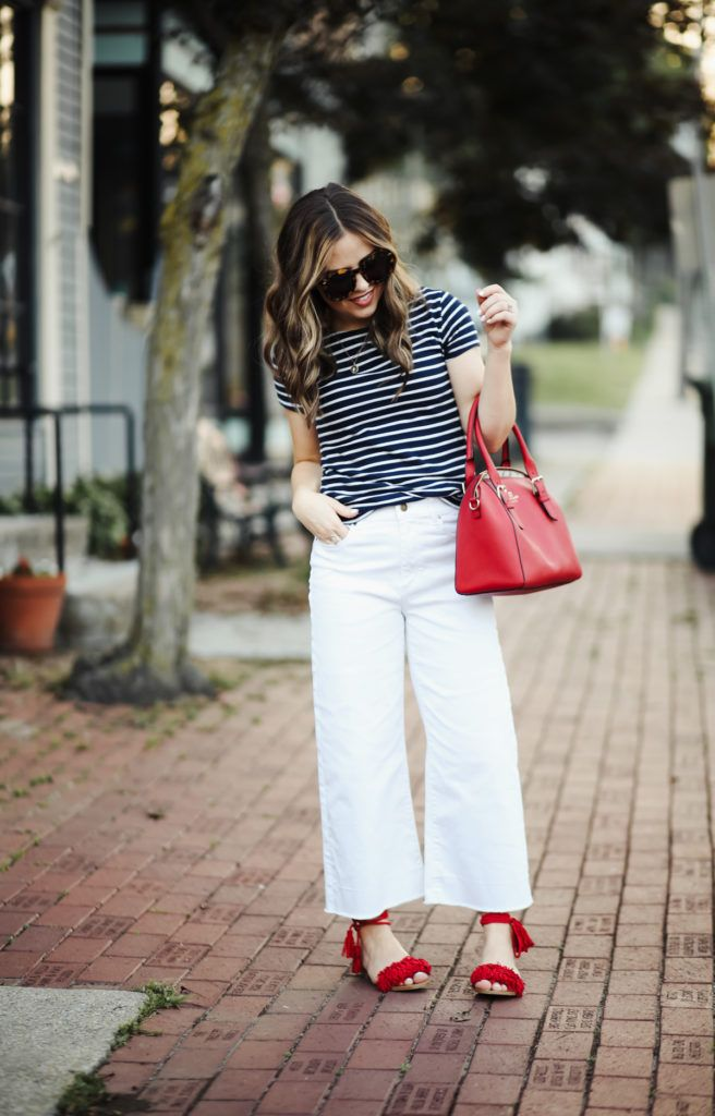 7dcc6dc5708 dress cori lynn. Navy and white striped t-shirt+white denim culottes+red  lace-up fringed flat sandals+red handbag+carey sunglasses.