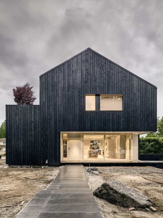 Passive house with fire treated wood cladding campos leckie studio inspiration for the rook - Modern home exterior wood ...