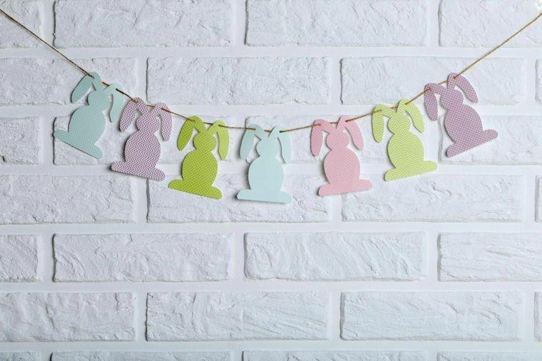 Photo of coniglietti-colorati-carta-filo-appeso-parete-orecchie-decorazioni-pasqua