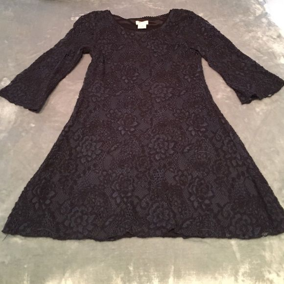 """Lace navy and black mini dress bell sleeves Sleeves are 3/4. Only flaw is on the end of one of the sleeves which is pictured. From top of shoulder to hem of the dress 28"""". Kids large but fits me and I am an xs Dresses Mini"""
