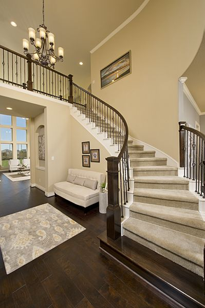 Firethorne Model Home Design 4931S Curved Staircase | New Home Stairs Design | Beautiful | Entrance | Iron | Stairway | Wall