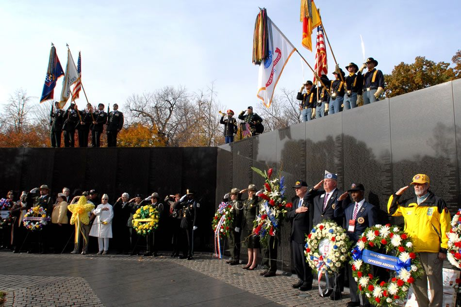U.S. military veterans render honors at the Vietnam War Memorial today in Washington, D.C., as part of the 15th Anniversary Commemoration at the Vietnam Women's Memorial. DoD photo by Army Staff Sgt. Michael J. Carden