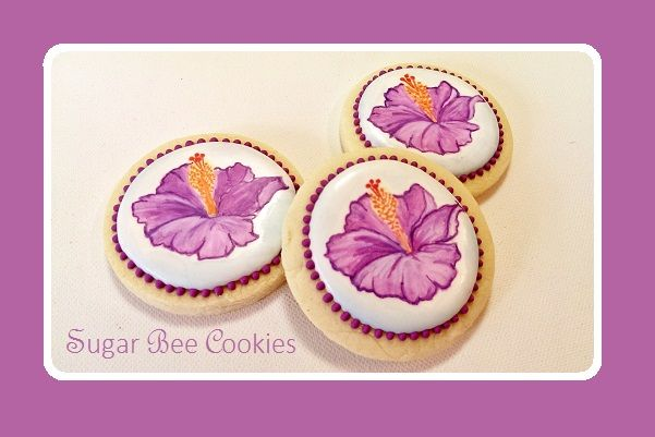 Painted hibiscus cookies for an Easter celebration. (Baked, designed, and painted by Krista Cook of Sugar Bee Cookies)