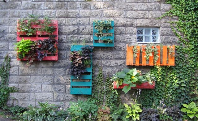 upcycle tip: turn unwanted wood pallets into fabulous planters, painted w/ bright colors and lined with burlap (can use landscape fabric as well).