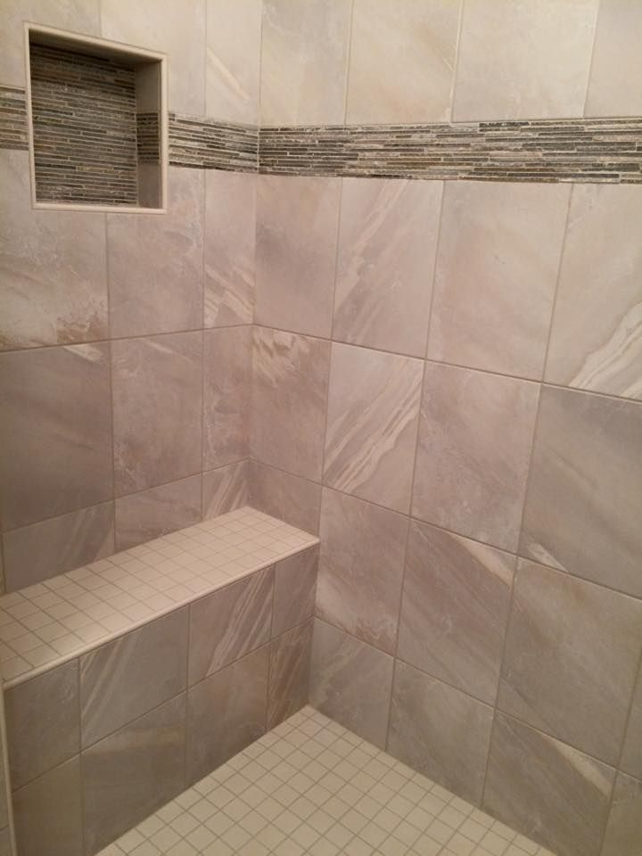 Bench seat in tile shower, accented by horizontal ribbon of tile ...