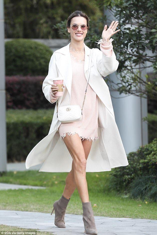 4dec126529 Alessandra Ambrosio wearing Gucci Gg Marmont Camera Bag in Mystic White