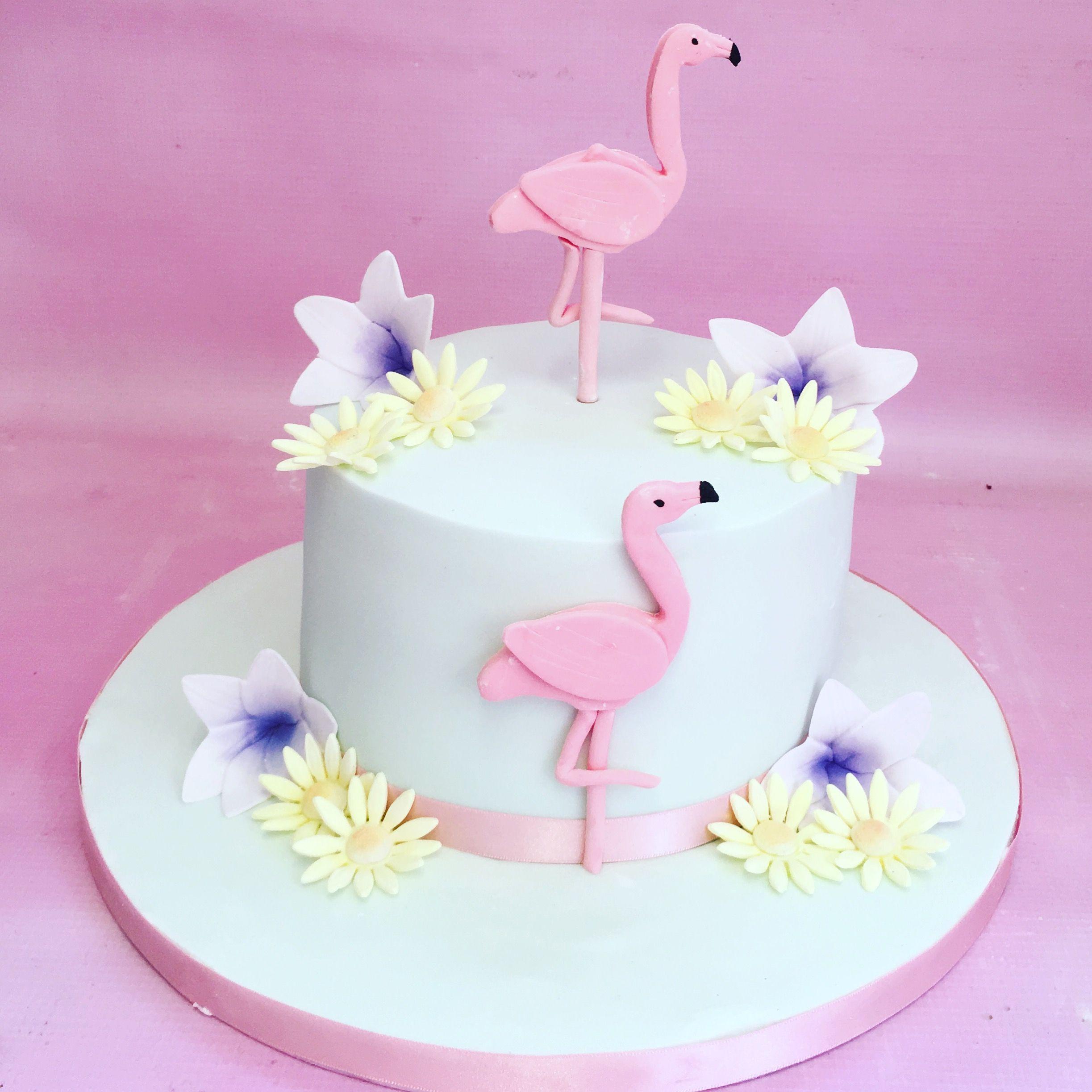 Single tier birthday cake with sugar flamingos and sugar