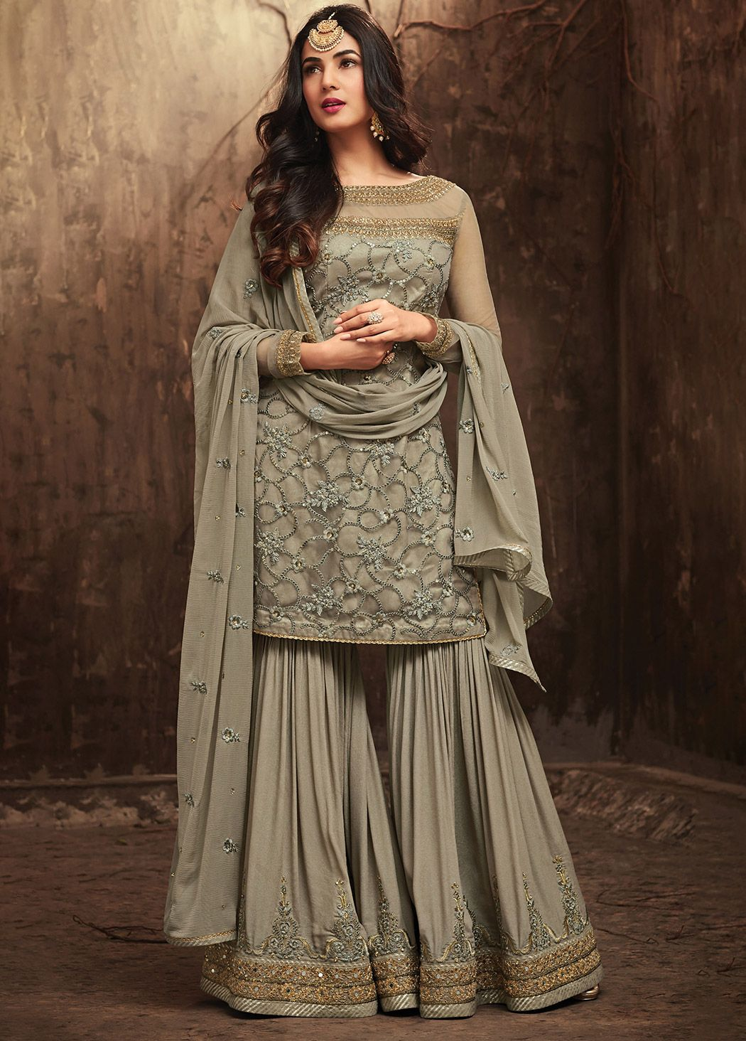 1819b40f73 Sonal Chauhan presents dark #grey #net #sharara #suit embellished with # embroidered #floral motifs and abstract #designs all over, which is  showcased with ...