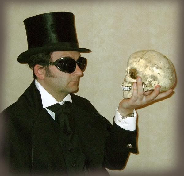 Top hat, Gothic coat, goggles, wing collar shirt, black velvet waistcoat and cravat, all within easy reach!    Oh, and a skull.