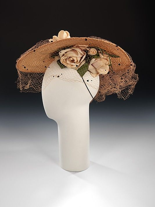 Hat.  Sally Victor  (American, 1905–1977).  Date: 1935. Culture: American. Medium: straw, linen, silk. Dimensions: 4 1/2 x 16 1/2 in. (11.4 x 41.9 cm).