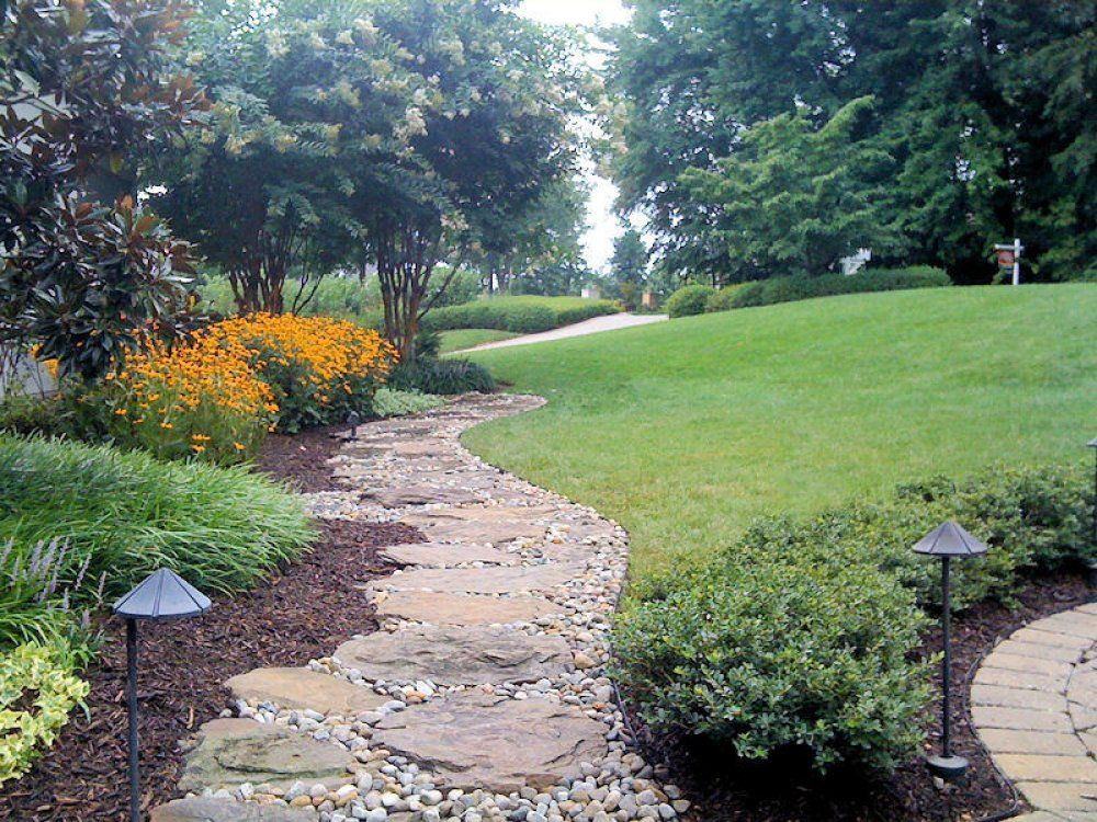 landscaping ideas river stone this landscaping project included a sustainable river rock pathway