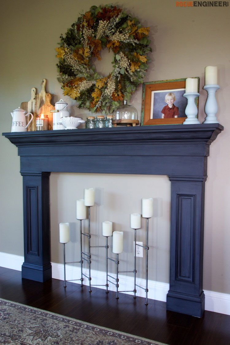 Faux fireplace mantel surround faux fireplace fireplace surrounds with the holidays coming up rogueengineer really wanted a mantel to doctorate and since they didnt have one they decided to build one solutioingenieria Images