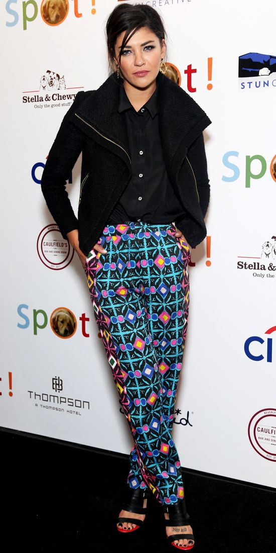 JESSICA SZOHR Szohr stood out in a pair of statement pants, keeping the rest of her look subdued with gold hoops, a black button-down moto j...